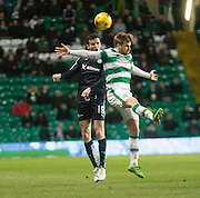 Dundee&rsquo;s Paul McGinn outjumps Celtic's Stuart Armstrong - Celtic v Dundee - Ladbrokes Scottish Premiership at Dens Park<br /> <br />  - &copy; David Young - www.davidyoungphoto.co.uk - email: davidyoungphoto@gmail.com