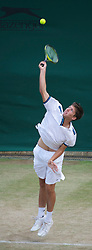 LONDON, ENGLAND - Friday, July 1, 2011: Oliver Golding (GBR) in action during the Boys' Doubles Quarter-Final match on day eleven of the Wimbledon Lawn Tennis Championships at the All England Lawn Tennis and Croquet Club. (Pic by David Rawcliffe/Propaganda)
