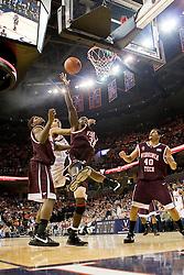 Virginia Tech forward/center Cheick Diakite (34) grabs a rebound over Virginia forward Mike Scott (32).  The Virginia Cavaliers men's basketball team fell to the Virginia Tech Hokies 70-69 in overtime at the John Paul Jones Arena in Charlottesville, VA on January 16, 2008.