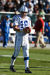 December 26, 2010; Oakland, CA, USA; Indianapolis Colts quarterback Peyton Manning (18) warms up before the game against the Oakland Raiders at Oakland-Alameda County Coliseum.