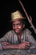 Portrait of a local woman in her mud home in the Fianarantsua Highlands