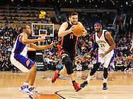 Jan. 24, 2012; Phoenix, AZ, USA; Toronto Raptors guard Linas Kleiza (11) drives the ball against the Phoenix Suns guard Sebastian Telfair (31) and forward Hakim Warrick (21) during the first half at the US Airways Center. The Raptors defeated the Suns 99-96.  Mandatory Credit: Jennifer Stewart-US PRESSWIRE.