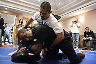 BIRMINGHAM, ENGLAND, NOVEMBER 2, 2011: Mark Munoz (top) works on his grappling with Rafael Cordeiro at the media open work-out sessions inside the Hilton Hotel on November 2, 2011.