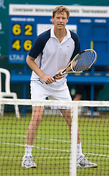 Liverpool, England - Friday, June 15, 2007: Peter Fleming in actions during the Legends Doubles on day four of the Liverpool International Tennis Tournament at Calderstones Park. For more information visit www.liverpooltennis.co.uk. (Pic by David Rawcliffe/Propaganda)