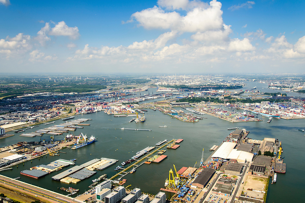 Nederland, Zuid-Holland, Rotterdam, 10-06-2015; Charlois, Waalhaven-Oost. Botlek aan de horizon.<br /> Rotterdam South with city harbours<br /> <br /> luchtfoto (toeslag op standard tarieven);<br /> aerial photo (additional fee required);<br /> copyright foto/photo Siebe Swart