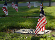 Goshen, New York - Flags decorate the graves at Orange County Veterans Cemetery on Saturday, May 29, 2010. The flags were placed in the cemetery for Memorial Day.