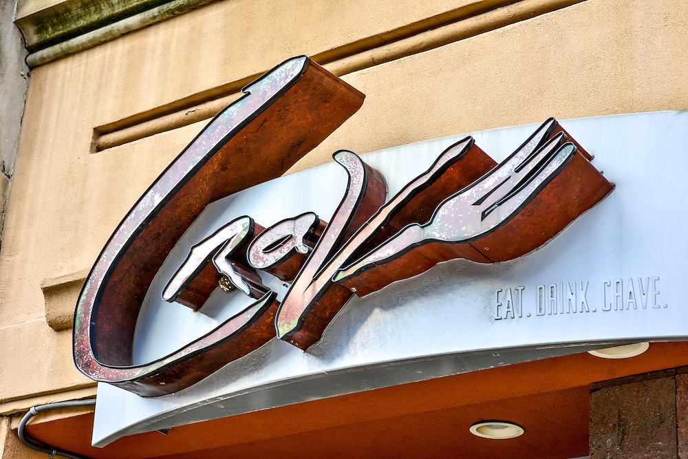 Close up of front entrance sign at Crave restaurant.