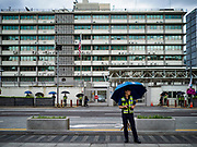SEOUL, SOUTH KOREA:  A South Korean policeman on duty in front of the US Embassy while about 25 people gathered in front of the embassy in Seoul to express their concerns about the upcoming summit between US President Donald Trump and North Korean leader Kim Jong-un. The people said they represented a coalition of labor and progressive groups.     PHOTO BY JACK KURTZ