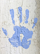 hand print on roughly painted surface
