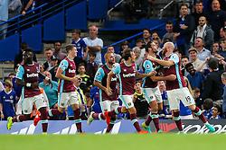 James Collins of West Ham United celebrates after he scores a goal to make it 1-1 - Rogan Thomson/JMP - 15/08/2016 - FOOTBALL - Stamford Bridge Stadium - London, England - Chelsea v West Ham United - Premier League Opening Weekend.