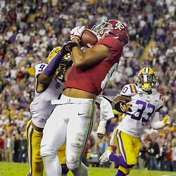 Nov 3, 2018; Baton Rouge, LA, USA; Alabama Crimson Tide tight end Irv Smith Jr. (82) catches a touchdown over LSU Tigers safety Grant Delpit (9) during the second quarter at Tiger Stadium. Mandatory Credit: Derick E. Hingle-USA TODAY Sports