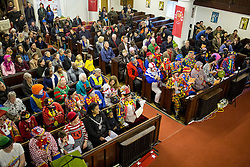 """© Licensed to London News Pictures. 05/02/2017. London, UK. Clowns attend the Grimaldi Church Service at Hackney at All Saints Church. The service commemorates the """"father"""" of the modern clown, Joseph Grimaldi. Photo credit : Tom Nicholson/LNP"""