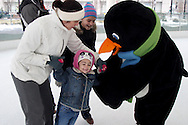 (from left) Maggie Hydler; Kayla Shackelford, 11; Justine Bowlin, 4, all of Huber Heights and Parker the Penquin during a session with the ice rink's mascot at the RiverScape MetroPark in downtown Dayton, Sunday, January 22, 2012.