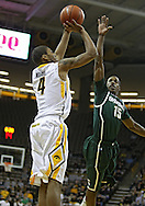 February 2 2011: Iowa Hawkeyes guard/forward Roy Devyn Marble (4) puts up a shot over Michigan State Spartans guard Durrell Summers (15) during the first half of an NCAA college basketball game at Carver-Hawkeye Arena in Iowa City, Iowa on February 2, 2011. Iowa defeated Michigan State 72-52.