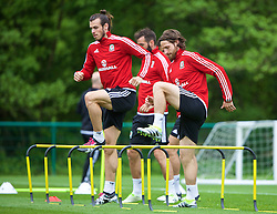 CARDIFF, WALES - Wednesday, June 1, 2016: Wales' Gareth Bale and Joe Allen during a training session at the Vale Resort Hotel ahead of the International Friendly match against Sweden. (Pic by David Rawcliffe/Propaganda)