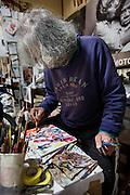 Kawasaki, November 21 2014 - Japanese artist Tatsumi ORIMOTO, 69, painting at home. while taking care of his 97-year-old mother.