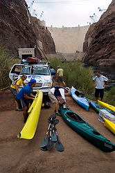 Kayaks, kayakers, no model release, on the Colorado River below Hoover Dam on border of Arizona, AZ, Nevada, NV, tourism, vacation, sports, preparation, sky, water, mountain, landscape, image nv427-18466.Photo copyright: Lee Foster, www.fostertravel.com, lee@fostertravel.com, 510-549-2202