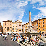 The Piazza in front of the Pantheon in Rome, with tourists milling about. Panoramic shot. High resolution.