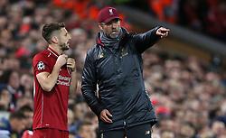 Liverpool's Adam Lallana speaks to Liverpool manager Jurgen Klopp