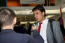 OSIJEK, CROATIA - Monday, October 15, 2012: Wales' manager Chris Coleman is interviewed at Osijek Airport as the squad arrive ahead of the Brazil 2014 FIFA World Cup Qualifying Group A match against Croatia. (Pic by David Rawcliffe/Propaganda)