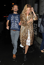 Actress Sienna Miller and fashion designer Matthew Williamson attend a private dinner hosted by British Vogue celebrating London Fashion Week SS14 at Balthazar in London, UK. 15/09/2013<br />BYLINE MUST READ : GOTCHAIMAGES.COM<br /><br />Copyright by © Gotcha Images Ltd. All rights reserved.<br />Usage of this image is conditional upon the acceptance <br />of Gotcha Images Ltd, terms and conditions available at<br />www.gotchaimages.com