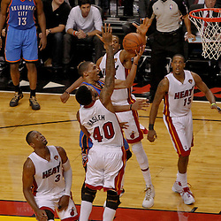 Jun 19, 2012; Miami, FL, USA; Oklahoma City Thunder point guard Russell Westbrook (0) shoots between Miami Heat power forward Udonis Haslem (40) and point guard Norris Cole (30) during the fourth quarter in game four in the 2012 NBA Finals at the American Airlines Arena. Mandatory Credit: Derick E. Hingle-US PRESSWIRE