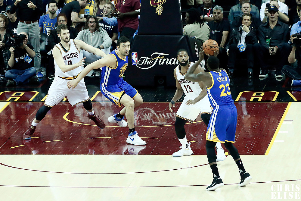 09 June 2017: Golden State Warriors forward Draymond Green (23) takes a jump shot over Cleveland Cavaliers center Tristan Thompson (13) while Golden State Warriors center Zaza Pachulia (27) defends on Cleveland Cavaliers forward Kevin Love (0) during the Cleveland Cavaliers 137-11 victory over the Golden State Warriors, in game 4 of the 2017 NBA Finals, at  the Quicken Loans Arena, Cleveland, Ohio, USA.