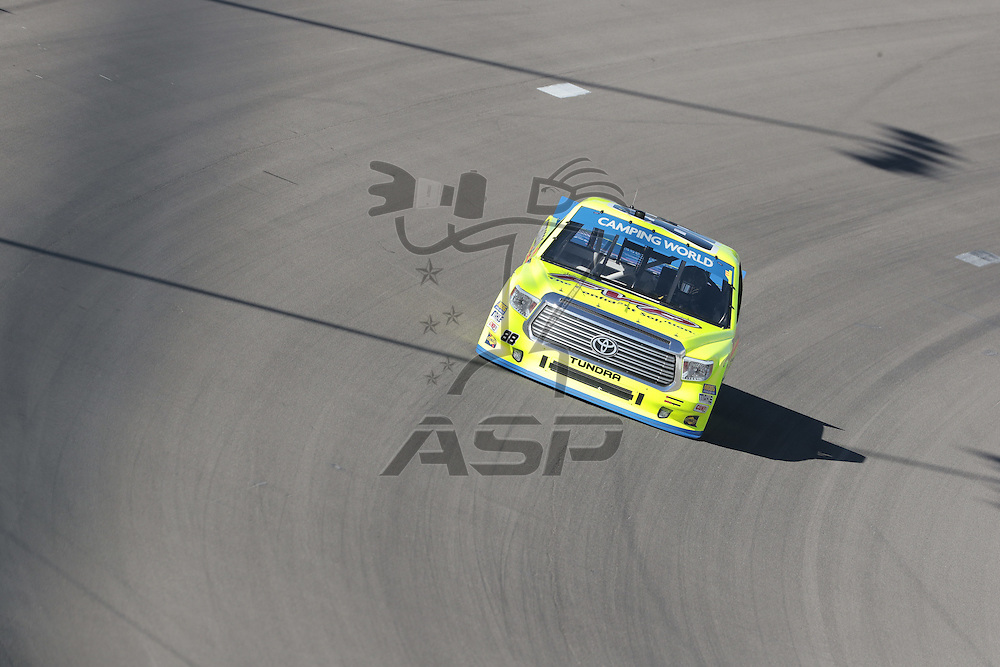 Las Vegas, NV - Oct 01, 2016:  The Camping World Truck Series teams race through the turns during a practice session for the DC Solar 350 at Las Vegas Motor Speedway in Las Vegas, NV.