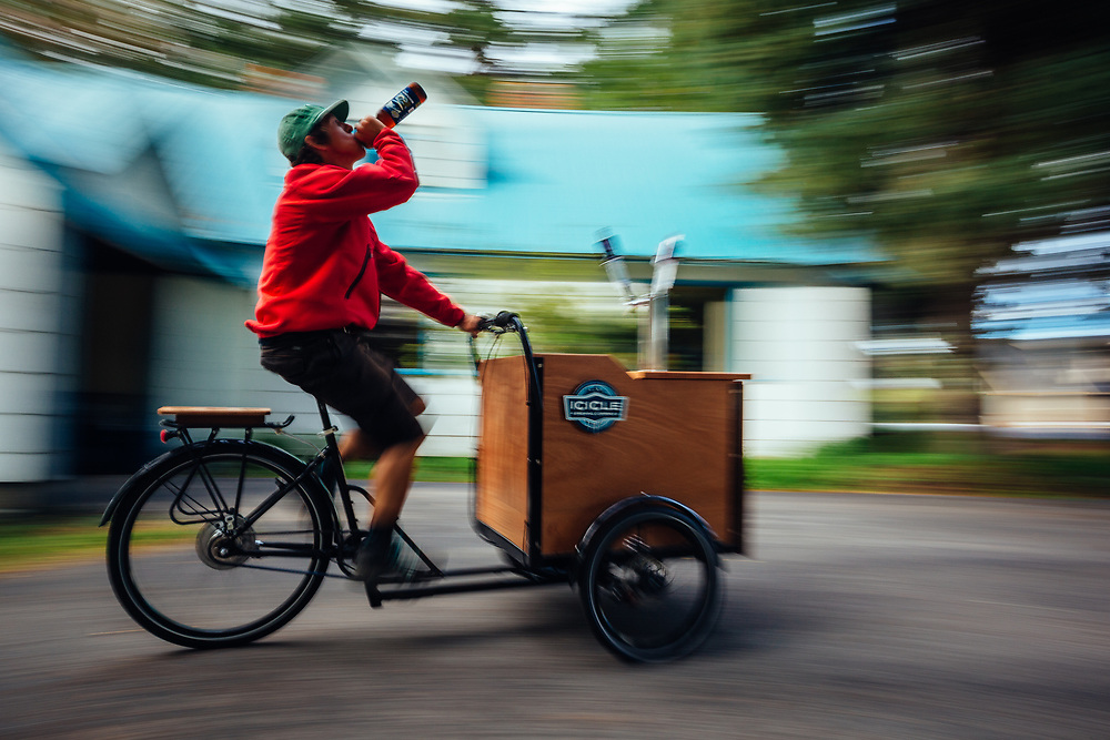 Rex Flake rides off with the beer bike from Icicle Brewing in Leavenworth, Washington.