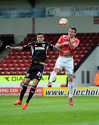 Bristol City's Marlon Pack battles for the high ball with Walsall's Andrew Butler  - Photo mandatory by-line: Joe Meredith/JMP - Mobile: 07966 386802 12/04/2014 - SPORT - FOOTBALL - Walsall - Banks' Stadium - Walsall v Bristol City - Sky Bet League One