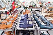 Corridonia, Marche - Veduta del calazurificio Santoni a Corridonia (Marche). Tutti gli operai sono altamente specializzati. Dalla scelta del pellame e del cuoio, al taglio della pelle, dalla velatura alla lucidatura. Ogni singola calzatura e fatta a mano. Le scarpe Santoni rappresentano il vero made in Italy.<br /> Ph. Roberto Salomone