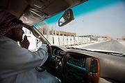 Mr. Hamad in his Toyota Landcruiser.