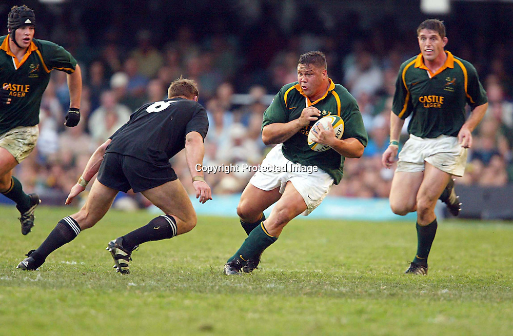 10 August 2002, ABSA Stadium Durban, Tri - Nations, Rugby Union. New Zealand v South Africa. Ollie Le Roux braces himself for the tackle of Scott Robertson. The All Blacks defeated the Springboks, 30-23.<br />Pic: Photosport
