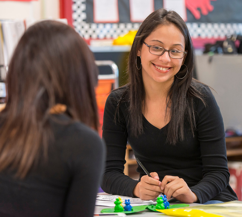 Norma Romero works with the parents of her Pre-K students during an Academic Parent Teacher Team (APTT) at Whittier Elementary School, May 15, 2014.