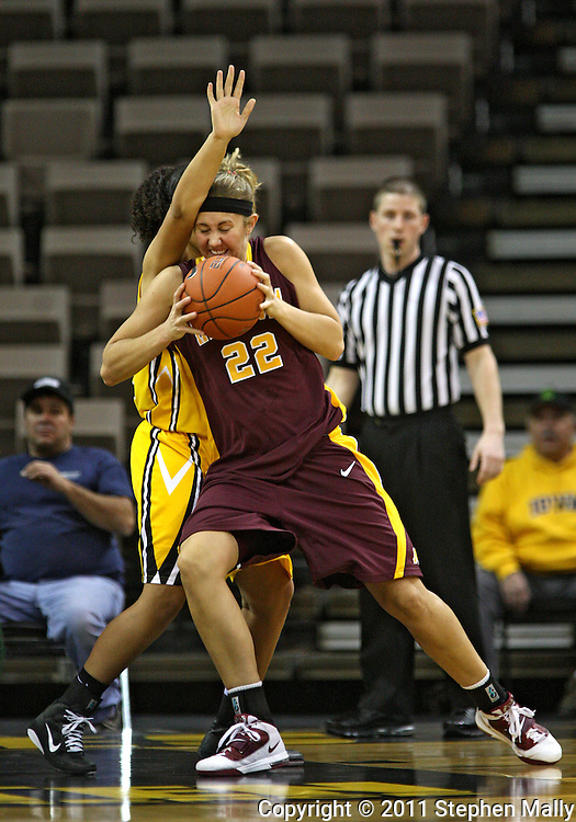 February 10 2011: Minnesota Golden Gophers forward Kristen Dockery (22) works against Iowa Hawkeyes forward Jade Rogers (32)  during the first half of an NCAA women's college basketball game at Carver-Hawkeye Arena in Iowa City, Iowa on February 10, 2011. Iowa defeated Minnesota 64-62.