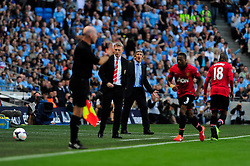 Manchester City Manager, Manuel Pellegrini protests a decision from the linesman - Photo mandatory by-line: Dougie Allward/JMP - Tel: Mobile: 07966 386802 22/09/2013 - SPORT - FOOTBALL - City of Manchester Stadium - Manchester - Manchester City V Manchester United - Barclays Premier League
