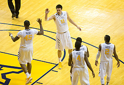 West Virginia Mountaineers guard Nathan Adrian (11) congratulates his teammates against the Texas Tech Red Raiders during the second half at the WVU Coliseum.