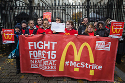 London, UK. 12 November, 2019. McDonald's workers belonging to the Bakers Food & Allied Workers Union (BFAWU) hold a letter to be delivered to Prime Minister Boris Johnson outside Downing Street during strike action, dubbed a 'McStrike', to call for a New Deal for McDonald's Workers which would include £15 an hour, an end to youth rates, the choice of guaranteed hours of up to 40 hours a week, notice of shifts four weeks in advance and union recognition.