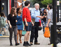 © London News Pictures. 28/07/2016. London, UK. Labour Party leader JEREMY CORBYN greets a local man as he returns to his London home following a verdict at the Royal Courts of Justice which upheld a decision by the NEC to guarantee Corbyn a place on the Labour Party leadership ballot.  Photo credit: Ben Cawthra/LNP