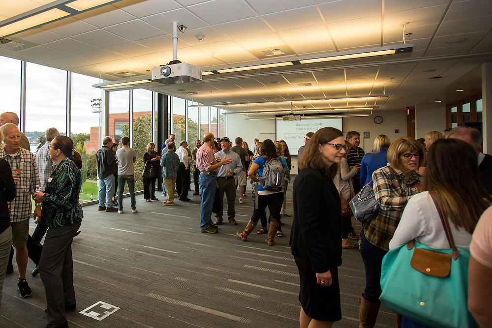 Parents and students meet with faculty and staff members on the third floor of the Hemmingson center on Friday during the 2015 Fall Family Weekend.