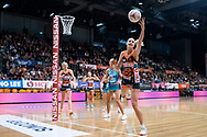 SYDNEY, NSW - JUNE 22: Caitlin Bassett of the Giants tries to catch the ball during the round 9 Super Netball match between the Giants and the Vixens at Quaycentre on June 22, 2019 in Sydney, Australia. (Photo by Speed Media/Icon Sportswire)