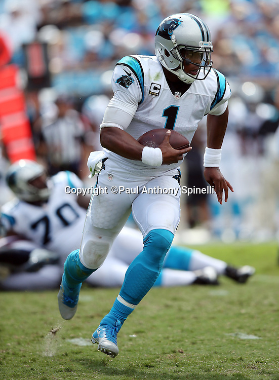 Carolina Panthers quarterback Cam Newton (1) runs for a gain of 19 yards and a third quarter first down during the 2015 NFL week 2 regular season football game against the Houston Texans on Sunday, Sept. 20, 2015 in Charlotte, N.C. The Panthers won the game 24-17. (©Paul Anthony Spinelli)
