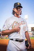 SAN FRANCISCO, CA - APRIL 18:  Madison Bumgarner #40 of the San Francisco Giants shows off  his  2014 World Series ring during the San Francisco Giants World Series ring ceremony at AT&T Park on Saturday, April 18 2015 in San Francisco, California. Photo by Jean Fruth