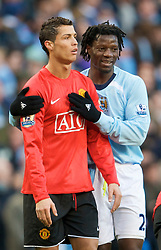 MANCHESTER, ENGLAND - Sunday, November 30, 2008: Manchester United's Christian Ronaldo cannot believe it as Manchester City's Mwaruwari Benjani informs him he's been shown the second yellow card and sent off during the Premiership match at the City of Manchester Stadium. (Photo by David Rawcliffe/Propaganda)