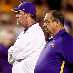 November 10, 2012; Baton Rouge, LA, USA; LSU Tigers defensive coordinator John Chavis and quarterback coach Steve Kragthorpe prior to kickoff of a game against the Mississippi State Bulldogs at Tiger Stadium.  Mandatory Credit: Derick E. Hingle-US PRESSWIRE