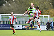 Forest Green Rovers Defender, Aarran Racine (21) beats Lincoln City Midfielder, Alex Woodyard (30) to the ball during the Vanarama National League match between Forest Green Rovers and Lincoln City at the New Lawn, Forest Green, United Kingdom on 19 November 2016. Photo by Adam Rivers.
