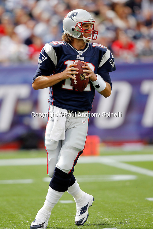 New England Patriots quarterback Tom Brady (12) drops back to pass during the NFL regular season week 3 football game against the Buffalo Bills on September 26, 2010 in Foxborough, Massachusetts. The Patriots won the game 38-30. (©Paul Anthony Spinelli)
