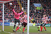 Lincoln City goalkeeper Ryan Allsop (22) makes a save  during the EFL Sky Bet League 2 match between Lincoln City and Exeter City at Sincil Bank, Lincoln, United Kingdom on 30 March 2018. Picture by Mick Atkins.