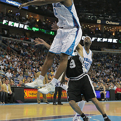 29 March 2009: New Orleans Hornets center Hilton Armstrong (12) blocks a shot by San Antonio Spurs guard Tony Parker (9) during a 90-86 victory by the New Orleans Hornets over Southwestern Division rivals the San Antonio Spurs at the New Orleans Arena in New Orleans, Louisiana.