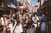 Crowds of people shopping in Harajuku District in Tokyo, Japan.